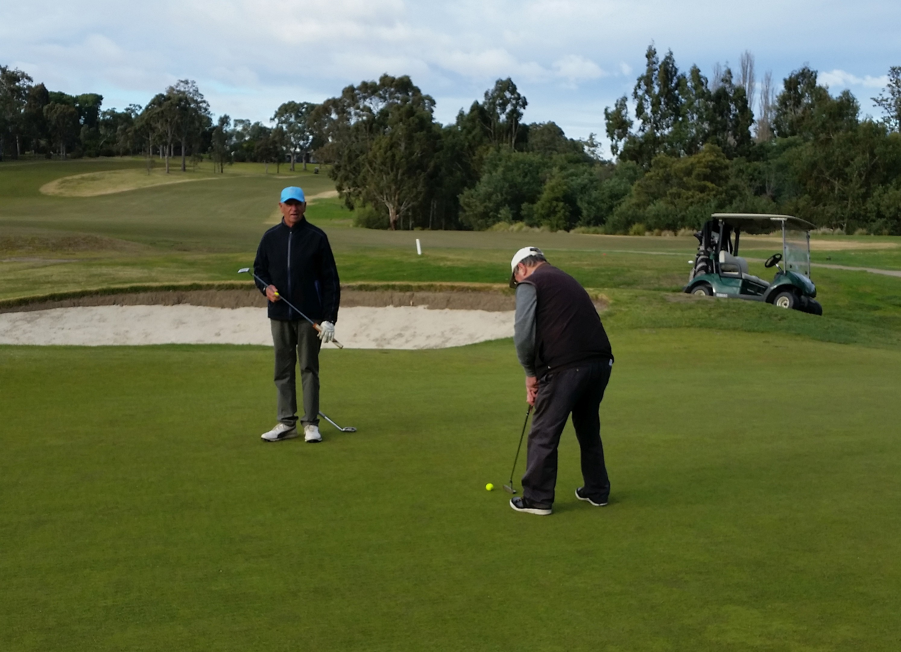 Peter Long watches Peter Perry putt.jpg