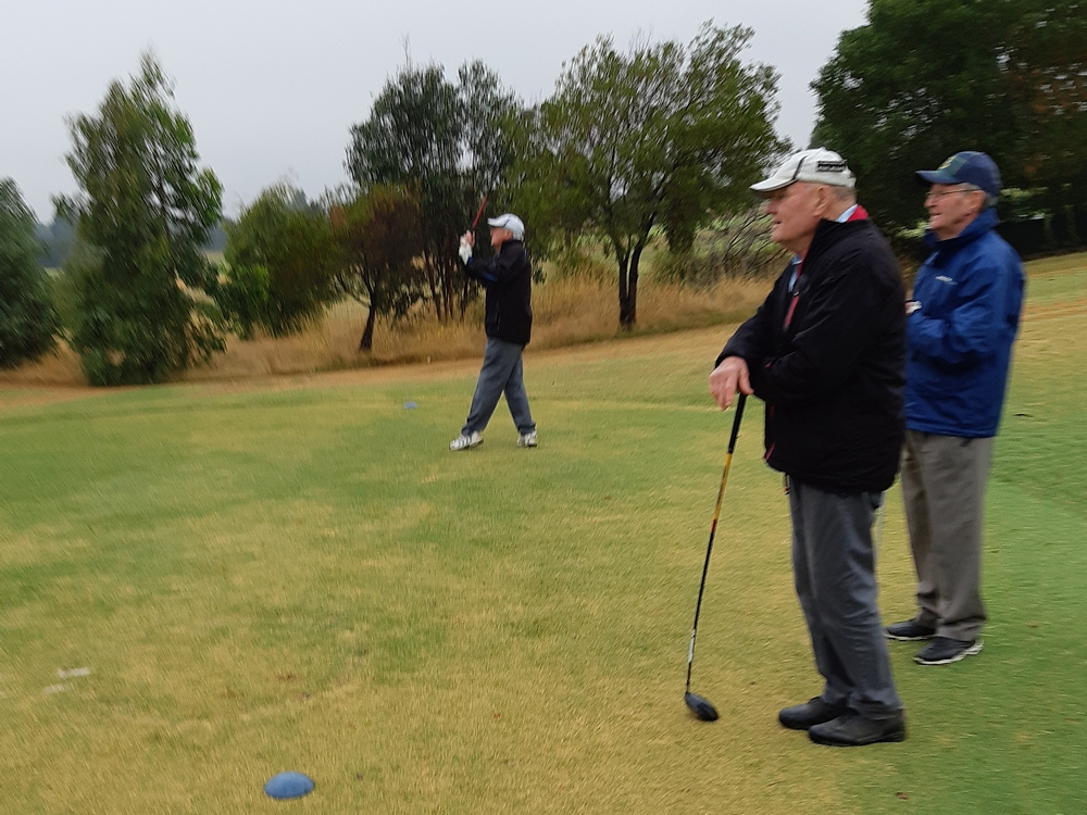 Michael Mulcahy and Malcolm Lansdown watch Rod Coling drive on the 1st.